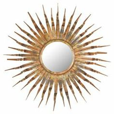 "Wall mirror with a wrought iron sunburst frame.   Product: Wall mirrorConstruction Material: Wrought iron and mirrored glassColor: Copper, gold and bronze   Features: Sunburst design Dimensions: 37"" Diameter"