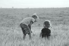 Kids playing on the great plains of the Maasai Mara in Kenya.