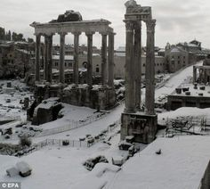 A rarely seen view of the Roman Forum in downtown Rome as a thick blanket of overnight snow covers the ground and ledges of the ancient site... Feb 4 2012