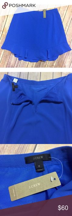 """J Crew Swing Skirt Drapey Twill Sz 12 NWT The secret to this skirt's versatility is all in the fabric—a classic twill that's extra soft and extra drapey.   Item Specifics Brand: J Crew Style: B909 Silouhette: A-Line Color: Bright Blue Size: US Womens 12 Orig Price: $98  Measurements in Inches (when laid flat) Waist: 17"""" Hips: 24"""" Sweep: 31"""" Front Length: 20.5"""" Back Length: 21""""   Garment Details Elastic Waist: No Hidden Zipper: Yes New With Tags: Yes Lined: Yes Materials: 100% Polyester J…"""