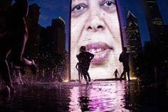 Children run thru the Crown Fountain located in Chicago's Millennium Park.