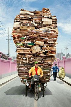 French photographer Alain Delorme, decided to zero in on the individual in his series Totems--specifically, Shanghai's migrants who bear the physical brunt of the fast-paced economy by hauling wares on their bikes and carts, like improvised trucks. We Are The World, People Around The World, Around The Worlds, Religions Du Monde, Doctor Images, Cargo Bike, Learn French, Mind Blown, Carry On