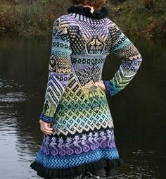 Amazing knitted coat made of left-over yarn. The pattern is put together from different patterns of mittens & socks she has knit. From Muffins Verden. Some awesome mittens featured on her blog, too..