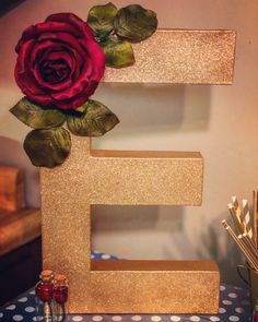 Beauty and the beast party decor. Letter, gold spray paint, and decorative rose all from hobby lobby