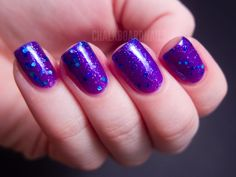 Bubble Yummy is an electric purple jelly base with fine silver glitter and medium blue glitter. I am wearing three coats in this swatch. It applied ... #blue #glitter #hex #nails #nailpolish