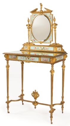 A French Gilt-bronze and Porcelain Mounted Dressing Table, Paris 19th century.
