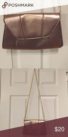 Metallic Rose Gold Crossbody Metallic rose gold crossbody with gold chain. Could be used as a clutch as well. Perfect for date night or a special event. Chain is 21 inches long. Purse is 9 x 6 Target Bags Crossbody Bags