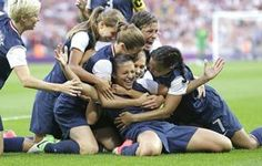 Carli Lloyd, center bottom, celebrates with teammates after scoring against Japan, as the U.S. won the gold medal in women's soccer. (PHOTO BY BEN CURTIS / AP)