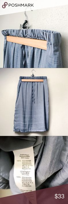 """Mid-Length Drawstring Skirt Classic mid-length skirt with drawstring waistband in a beautiful bluish gray; silky exterior with inner lining. In excellent pre-loved condition with no noticeable flaws.   L: 26.5"""" Waist: 13.5""""  ✅Bundle & Save 🚫Trades 🚫Off-Posh 🚫Modeling  ✔️All measurements are closest approximation.✔️  💞Shop with ease; I'm a Posh Ambassador.💞 GAP Skirts"""