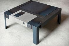 Do you miss 90's? You would feel like time travelling if you kept in your room this coffee table that is made to resemble a classic 3.5″ floppy disk. www.fantastisch.com/floppytable