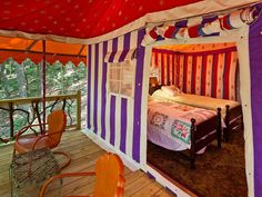 A peek at the inside of a tent at The Martyn House in Ellijay, Georgia, furnished with European antiques and luxurious bedding. They call this form of camping