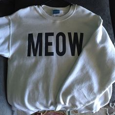 Urban Outfitters Meow Sweater Sadly only worn a handful of times! White just isn't my color. Super super comfy noodie! Urban Outfitters Tops Sweatshirts & Hoodies