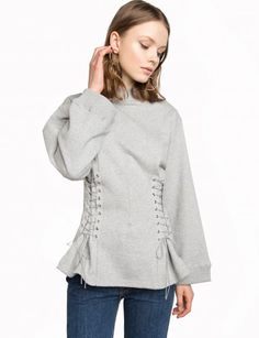 GreyLace Up Corset Waist Sweatshirt Estimated arrival April 19-25, 2017USE 15% OFF CODE PREORDER at checkoutPre-orders can only be shipped within the continental US.Arrival date is not guaranteed  100% cottonMade by usModel is wearing a size small and model's height is 5.9