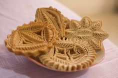 'uniquely bengali food - pakhan pitha, a syrupy and crispy fried cake' I HAVE NOT HAD THESE IN FOREVER. They remind me of childhood <3