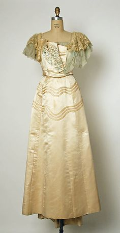 Embroidered ivory silk satin evening dress, by House of Drécoll, Austrian, ca. 1897.