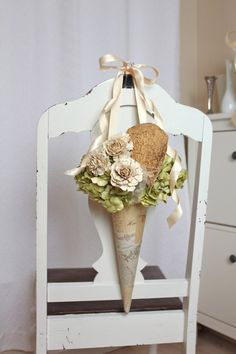 Rustic natural paper flower pew cone with mushroom and wood rose details for your wedding decor