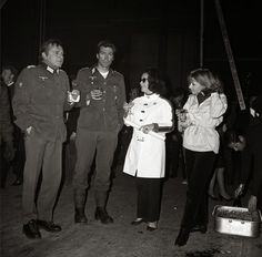 Richard Burton, Elizabeth Taylor, Clint Eastwood and Ingrid Pitt enjoy a cocktail at the end of the day's shooting of Where Eagles Dare - 1969