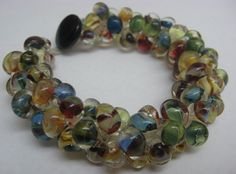 Boro and Macrame Bracelet in multi color Boro drop beads, an original design by Cheryl Erickson.  Instructions and kits available in this and other colors from www.artisticbead.com