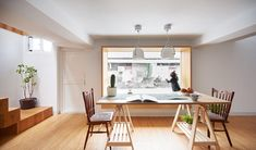 exploring space and lighting, the renovation of the old-style building features the classic two and a half-storey floor plan opened up to create new light-filled family spaces.