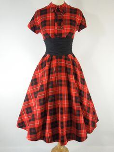 A Christmas sort of red tartan 1950s dress with a ruched black belt.