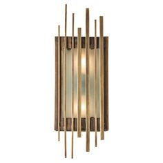 This two-light, brass sconce features frosted glass panels on the front and sides. With its brass antiqued rods of varying length, the sconce creates a cage-like pattern that casts arresting light against the walls. Perfect to be hung vertically or horizontally. Material: Brass, Glass Finish: Antique Brass