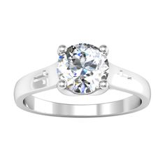 Cross solitaire engagement ring