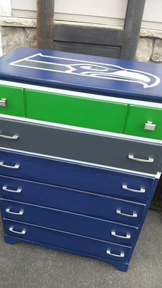 Seahawks theme dresser for Brenda's son. Given new life with Fusion Mineral Paint, sealed for protection, distressed before her son gets to it  But really, isn't that just the right design for kids, though? Thank you, Brenda, for letting me be creative for your home furnishings!  #CityChickenFurniture #paintedfurniture #Fusionpaint #Seahawks #GoHawks