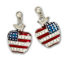 American flag drop earrings in the shape of an apple, with red enamel and diamond like Swarovski crystals stripes. The stars are gold dots with a blue enamel background. Only available in gold plate.