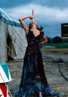 """Cameron Diaz lensed Diaz lensed by Annie Leibovitz, for Vogue May 2003 portfolio, """"Shooting Star,"""" focusing on familiar Circus sights and acts. Cameron Diaz, Annie Leibovitz Photos, Annie Leibovitz Photography, Pantomime, Vanity Fair, Circus Aesthetic, Sword Swallower, Dark Circus, Circus Performers"""