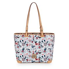 [Star spangled bag]Mickey is just one of the stars on the patriotic print of this leather shopper tote by Dooney & Bourke. You'll show your allegiance wherever you go carrying this stylish bag that's as American as apple pie.