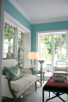 Inspired by Jenny's love for water and coastal style, this soothing paint color, Farrow and Ball Arctic Sea, brings peace and tranquility to her sunroom / home office.