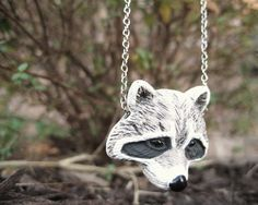 Hey, I found this really awesome Etsy listing at https://www.etsy.com/listing/84347910/raccoon-necklace-animal-pendant-necklace
