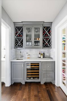The Cantina Hammered Copper Bar & Kitchen Prep Sink shines in this gray wet bar by Designstorms
