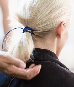 Using an unconventional hair tie instantly adds polish to a 10-second hairstyle.