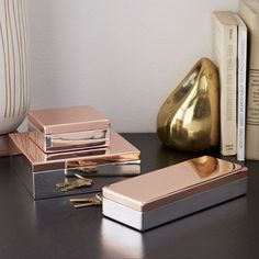 Metallic Glimmer Boxes--- Made of steel with a felt-lined interior, our Metallic Glimmer Boxes bring festive shine to tabletops and dressers.