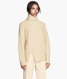 Beige rib-knit turtleneck sweater in wool blend with camel-hair content. Slits at hem. | Warm in H&M