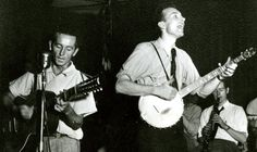 Woody Guthrie, at left with guitar, and Pete Seeger, with banjo