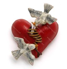 Stitching a Broken Heart - World Folk Art - Find Stained Gourds, Metal Wall Hangings, and more
