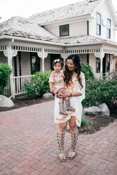 Mom and daughter wearing @jessicahaley gladiator sandals