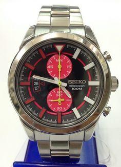 Montre Homme Seiko SNN287P1, boîtier et bracelet en acier, cadran noir et rouge, fonction chronographe et date.