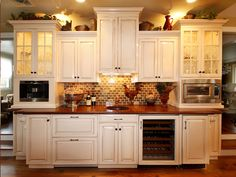 I like mixing the height of the cabinets