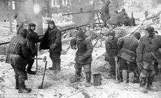 Bleak: Soviet inmates at the frozen prison camp in Norilsk, Siberia, in 1945. The camps, often in the middle of nowhere, were surrounded with barbed wire and watchtowers