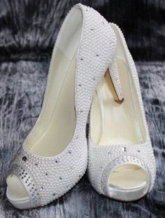 Wedding shoes  white which are covered in Swarovski by Bridetobead, £79.99