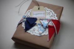 Bunting, doily, and kraft gift packaging.
