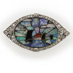 An Art Deco opal, onyx and diamond brooch, the oval panel with opal, onyx and hardstone mosaic depicting a maritime scene at sunset, within a delicately scalloped rose-cut diamond set border, all to a closed back setting