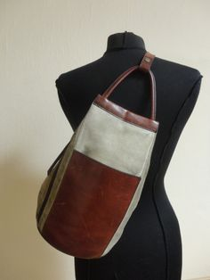 Vintage Authentic Suede and Leather Sling bucket shoulder bag tote purse. $49.99, via Etsy.