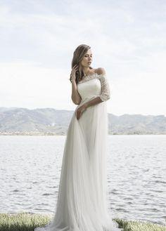 abito da sposa stile impero con corpino di pizzo rebrodè,maniche 3/4 scollo omerale,  gonna in tulle