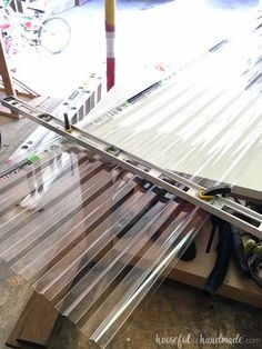 I love how easy the clear corrugated roof panels are to cut. You can easily DIY a pergola roof! Housefulofhandmade.com