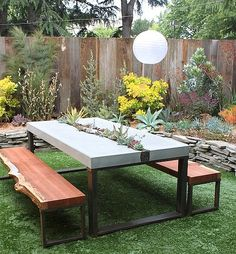 Add a major statement piece to your lawn. This custom-built succulent table was commissioned and built by DIG Gardens. Want to try your hand at a backyard table? You can learn to pour your own concrete tabletop on ReadyMade. Outdoor Spaces, Outdoor Living, Outdoor Decor, Garden Furniture, Outdoor Furniture Sets, Dig Gardens, Patio Table, Picnic Table, Garden Table