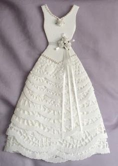 I've been making more paper dresses ... and finding them a bit addictive ...   Another wedding dress made mainly with doilies ... this measu...